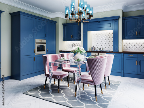 A colorful kitchen in a neoclassic style with blue furniture and green walls, a dining table with soft pink chairs.