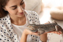 Woman Holding Bearded Lizard I...