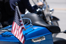 US Flag On The Back Of A Blue Motorcycle