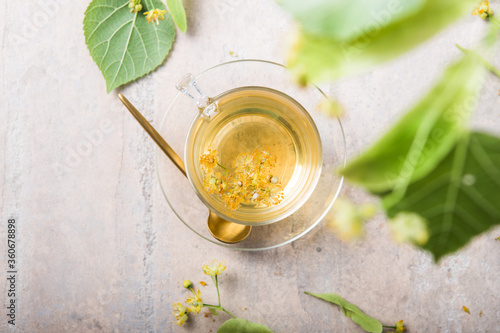 Fototapeta Glass Of Herbal Tea With Linden Flowers obraz