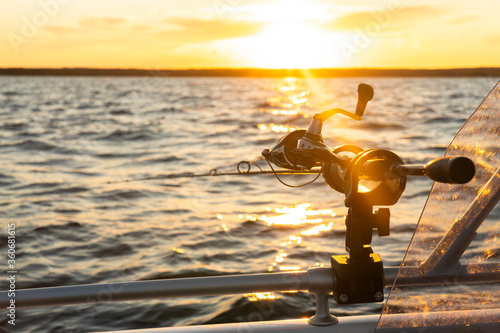 Fishing rod spinning with the line close-up Canvas Print