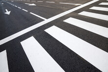 Arrow Directional Signals And Zebra Crossing Painted On The Floor In Spain