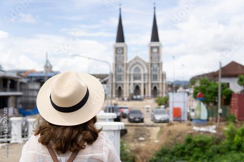 Travel woman is enjoy watching and traveling at Maephra Patisonti Niramon Church ,Chantaburi province in THAILAND Tapéta, Fotótapéta