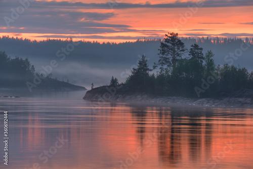 Fotografie, Obraz Foggy morning on lake Islands, lake Ladoga, Republic of Karelia, Russia