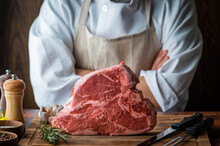 Thick Cutted T-bone Steak With Butcher Man