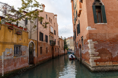 Venice, Italy - CIRCA 2020: View of an empty water canal in Venice Italy. Concept of the effects of lock down due to CoronaVirus COVID-19. Picturesque landscape.
