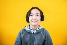 Young Filipino Boy On Headphon...