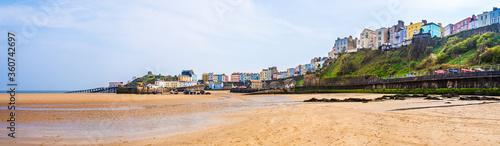 Fototapeta Colorful houses on the beach shoreline in Tenby, Pembrokeshire, Wales, UK obraz