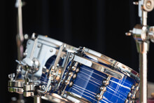 Close-up Shot Of A Blue Drum Set In A Dark Room With Selective Focus.