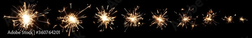 Series of burning sparklers with lots of hot glowing embers exploding and burning away. For New Years or 4th of July celebration.