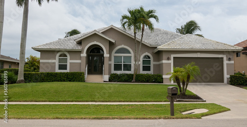 Typical private home at an affluent residential area on Marco Island, Florida. #360765893