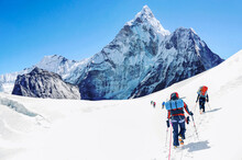 Group Of Climbers Reaching The...