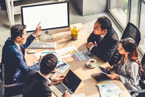 Obraz Smart businessman and businesswoman talking discussion in group meeting at office table in a modern office interior. Business collaboration strategic planning and brainstorming of coworkers. - fototapety do salonu