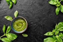 Pesto. Italian Basil Pesto Sauce On Black Background. Flat Lay
