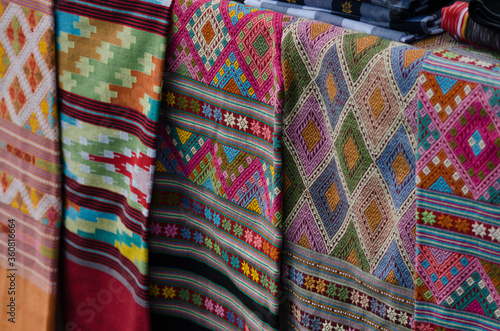 Fototapeta Thai silk is woven using ancient methods of weaving