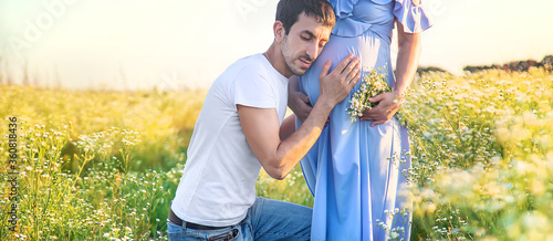 Obraz pregnant woman and man hold belly together. Selective focus. - fototapety do salonu