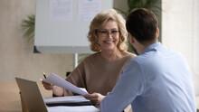 Smiling Mature Businesswoman W...
