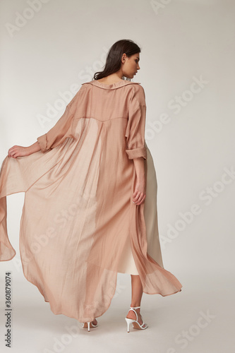Beautiful woman fashion model makeup brunette hair perfect body shape tanned skin wear clothes summer collection organic silk dress and long shirt cape stylish sandals shoes, accessory romantic Wallpaper Mural