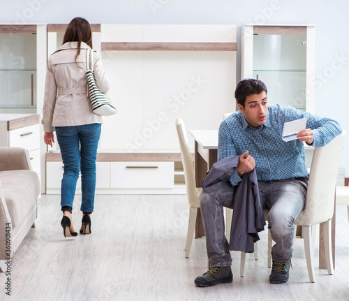 Fotografie, Tablou Young couple disappointed with price in furniture store