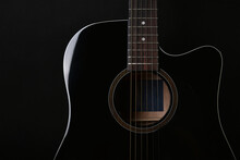 Black Acoustic Guitar Studio Shot On Black Background With Copyspace, Guitar Is Favorite Music Instrument For Hobby.