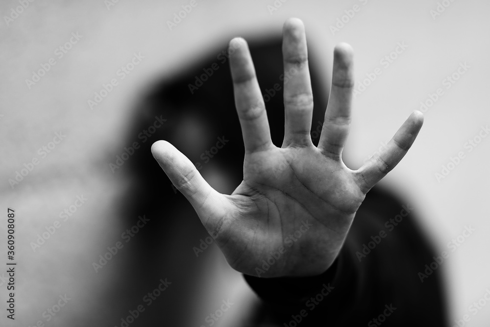 Fototapeta hand of the little girl who wants to protect herself with black