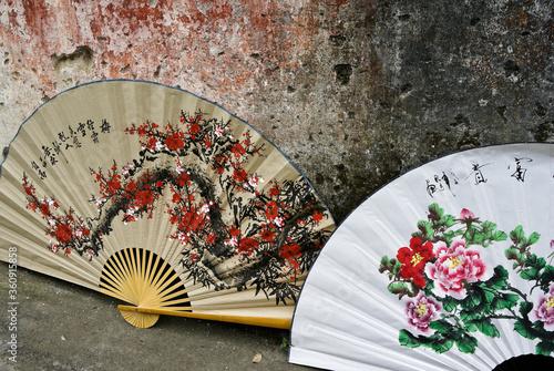Fototapeta Large, hand-painted, decorative fans for sale outside a shop in Fuli, Guangxi Pr