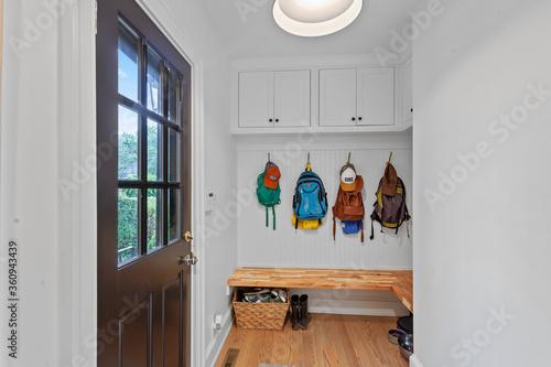 Billede på lærred Mudroom with backpacks and outdoor door
