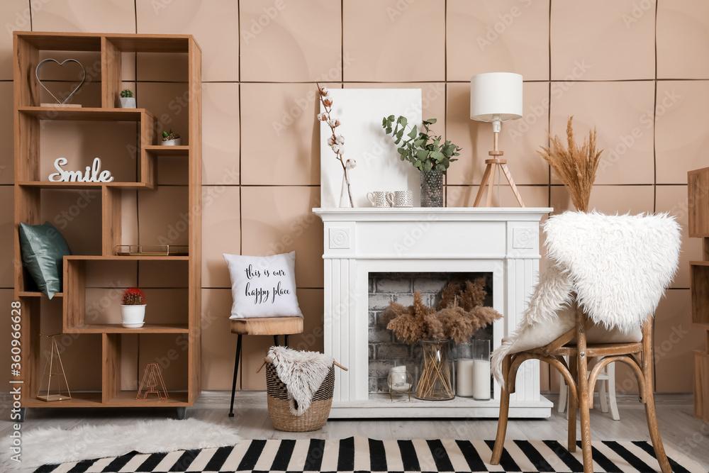 Fototapeta Stylish fireplace in interior of living room