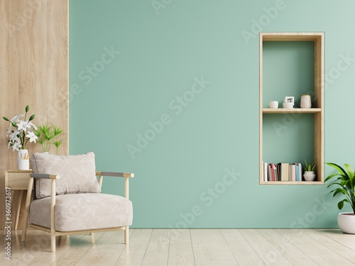 The interior has a armchair on empty green wall background. Fototapet
