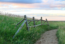 Fence Post Along Trail At Sunset