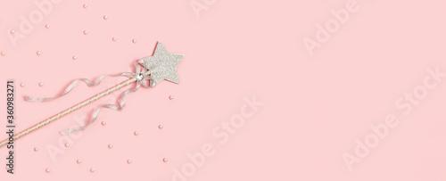 Obraz na plátně Festive decoration, magic wand, bright silver star with shine on soft pink background with copy space