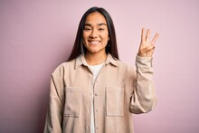 Young Beautiful Asian Woman We...