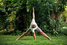 Man Practice Yoga In The Tropi...