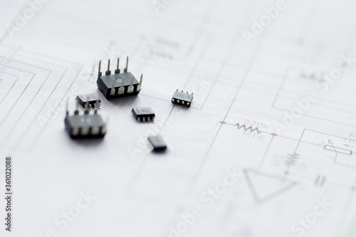 Obraz na plátně Electronic parts on the background of the schematic diagram