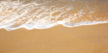 Empty Sandy Beach  With Soft Wave On The Beach, Summer Background.Copy Space