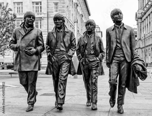 Liverpool, England - May 28, 2017: Bronze Statues of The Beatles located on Pier Head, They were created by Andy Edwards and unveiled in December 2015