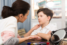 Boy During Serious Talk With Mother