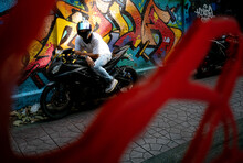 Young Boy Sitting On A Motorbi...