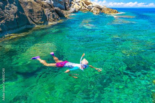 Female snorkeling in Sant 'Andrea beach and Cote Piane side in Elba island Wallpaper Mural