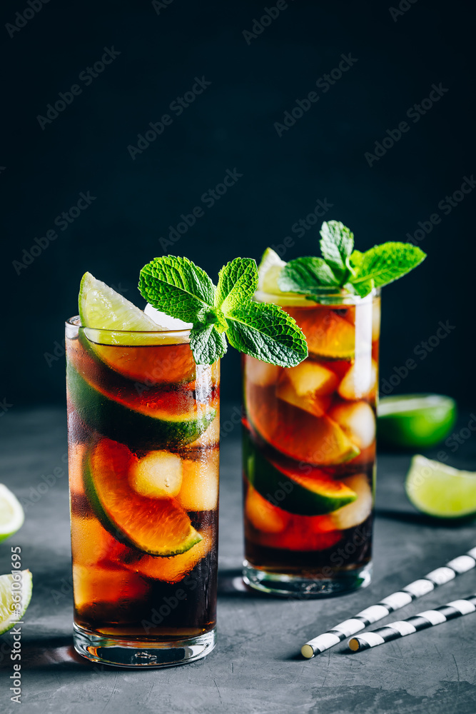 Fototapeta Rum and Cola Cuba Libre ice cold drink cocktail with lime and mint