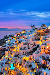 Panel Szklany Architektura Famous greek iconic selfie spot tourist destination Oia village with traditional white houses and windmills in Santorini island in the evening blue hour, Greece
