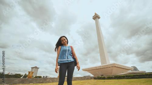 Indonesian girl posing on the background of the Monas monument. Slika na platnu
