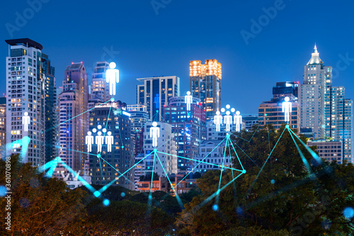 Photo Glowing Social media icons on night panoramic city view of Bangkok, Asia