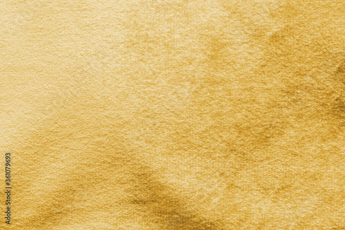 Fotografija Gold velvet background or golden yellow velour flannel texture made of cotton or