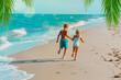 Leinwandbild Motiv happy boy and girl running on tropical beach