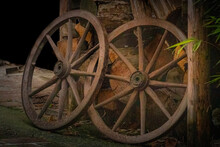 Two Old Wagon Wheels Leaning O...