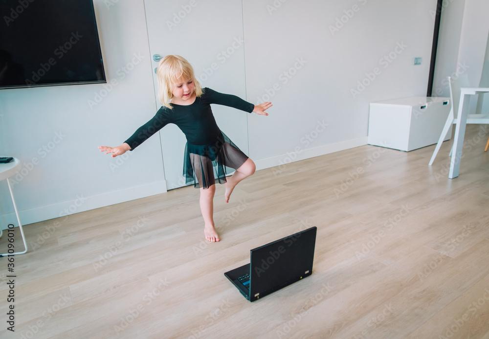 Fototapeta Ballet or gymastics lesson online. Remote learning for kids.