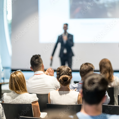 Fotografie, Obraz Male speaker giving a talk in conference hall at business event