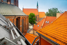 Traditional Architecture Of Old Town Of Riga, Latvia. Close-up Of Red Tile Roofs. Riga Cathedral. Tourism In Europe.
