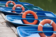 Rows Of Blue Rental Boats With...